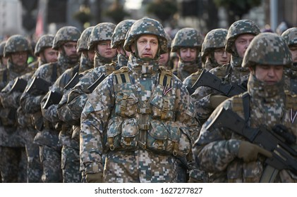 14-08-2018 Riga, Latvia Camouflaged soldier marching in formation.