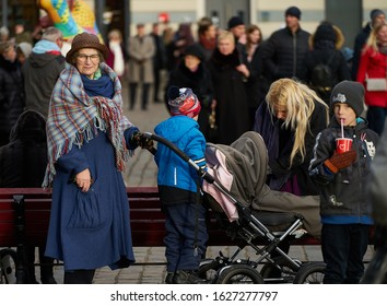 14-08-2018 Riga, Latvia. Grandmother with a baby in a stroller.
