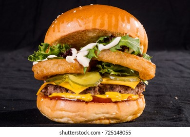 140grm Wagyu beef burger with onion rings, cheese, lettuce, tomato, pickles, tomato sauce, mustard, aioli on a brioche bun