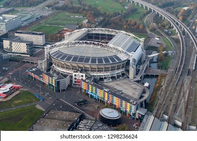 14-11-2018, Amsterdam, Netherlands. Aerial view of Johan Cruijff Arena and shopping mall with Decathlon and Prenatal.  The soccer stadium is home of team Ajax and will host games during the Euro 2020