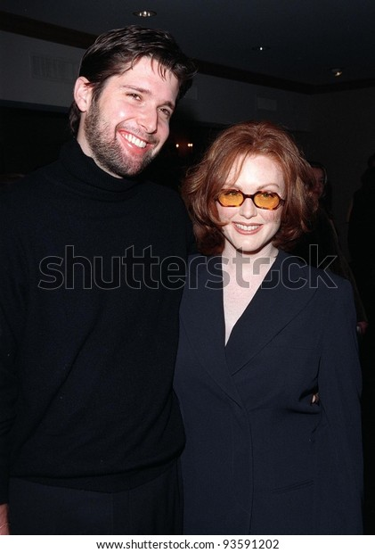 "14JAN98: Actress JUIANNE MOORE & husband at the L.A. Film Critics Assoc. Awards where she won the Best Supporting Actress award for ""Boogie Nights."""