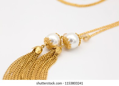 14K gold pearl necklace close up.