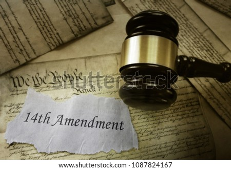 14th Amendment news headline on pages of the US Consitution