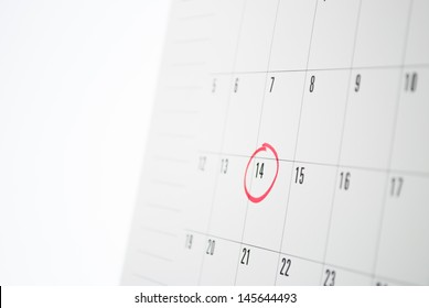 14th date of calender circled with red color marker