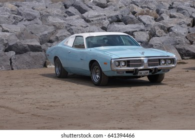 14th May 2017- A classic 1970's Dodge coupé parked on the sandy beach at Pendine, Carmarthenshire, Wales, UK.