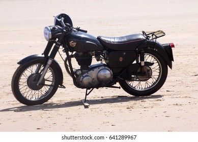 14th May 2017- A vintage Matchless motorcycle parked on the sandy beach at Pendine, Carmarthenshire, Wales, UK.