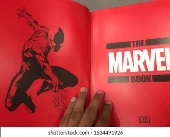 """14th October 2019, Shah Alam, Malaysia. Hand holding the famous """"Marvel"""" book. Marvel Comics is the brand name and primary imprint of Marvel."""