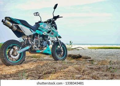14th.March.2019,Kuantan,Malaysia. A mini motorcycle with Petronas decal park on the sand at beach.