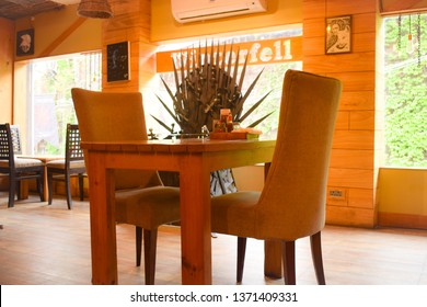 15 April 2018. Empty chairs for couple in the restaurant named as winterfell after famous game of thrones drama by HBO in kashmir ,India. In background replica of iron throne from the game of thrones