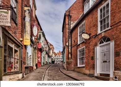 15 February 2015: Lincoln, UK - Steep Hill, famous very steep shopping street in the city.