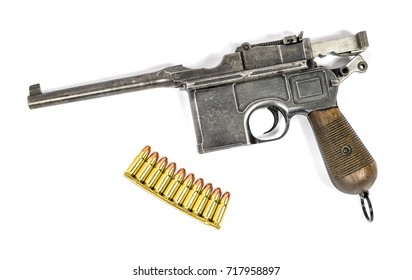 15 MARCH 2017, BRNO, CZECH REPUBLIC: Pistol Mauser C96 with ammo isolated on white background
