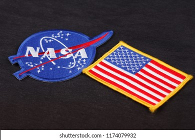 15 March 2018 - The National Aeronautics and Space Administration (NASA) emblem patch and US Flag patch on black uniform background