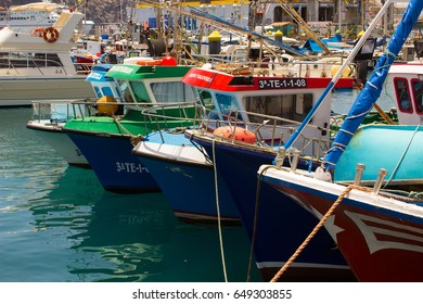 15 May 2017 Colorful boats packed into the harbor and marina at Los Cristianos ferry terminal  in Tenerife on a hot summer day