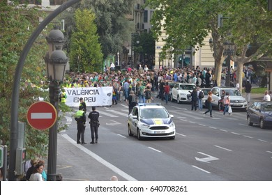 """15 MAY 2017, VALENCIA, SPAIN. Anti-corruption and anti-governement spanish opposition movement """"15M"""" are marching down the street in Valencia, police is watching"""
