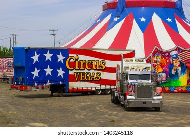 15 May 2019 The Red, White and Blue Big Top of the Travelling American Circus in Ireland with the stars and stripes surrounded by the performers caravans and equipment in Bangor  in Northern Ireland