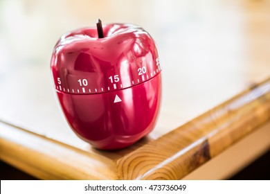15 Minutes - Kitchen Egg Timer In Apple Shape On Wooden Table