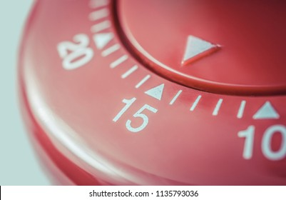 15 Minutes - Macro Of A Flat Red Kitchen Egg Timer