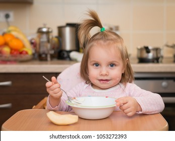 1,5 years baby girl eating by herself
