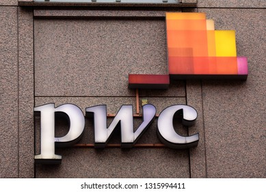 15.02.2019. RIGA, LATVIA. Logo of PWC company on facade of building in Riga city. PWC is a multinational professional services network company.