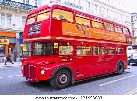 15.03.2015.Londoner red double decker vintage bus in a street with people, London UK