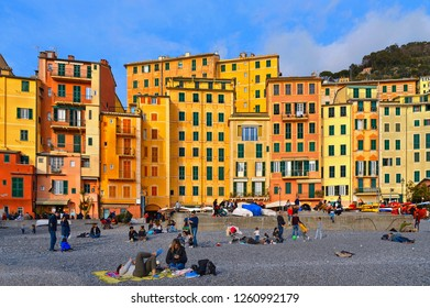 15.03.2017. Glimpse of historical Old Town Camogli and sand beach with crowd of people on mediterranean coast in Camogli, italian Riviera, Italy