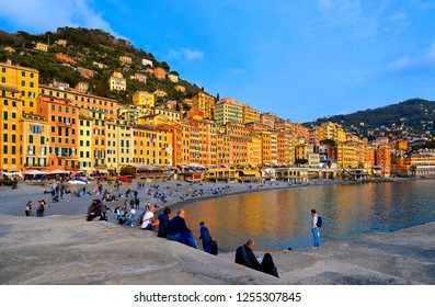 15.03.2017. Panoramic view of historical Old Town Camogli and sand beach with crowd of people on mediterranean coast in Camogli, italian Riviera, Italy