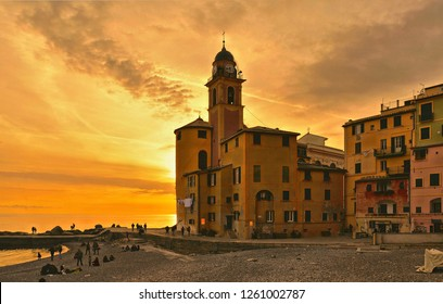 15.03.2017. Panoramic view of historical Old Town Camogli and sand beach with people on sunset in mediterranean coast in Camogli, italian Riviera, Italy