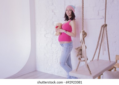 """15.05.2016 Russia. Moscow. Photostudio """"Balioz"""" Pregnant girl on a white wall background"""