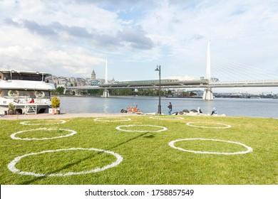 İstanbul-Turkey - 15-06-2020: social distance circles drawn on the grass