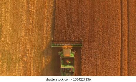 15.07.2018 - Tetiiv, Ukraine. Combine with golden field. Top view of agricultural machine.