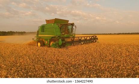 15.07.2018 - Tetiiv, Ukraine. Combine on golden field. Agribusiness and technologies.