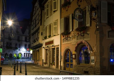 15.08. 2019. Medieval small town Kaysersberg, region Alsace at night. France. Colorful  street in old town, medieval architecture. Tourism on the Alsace Wine Route. Famous tourism destination.