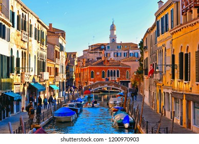 15.11.2017.Venice colorful corners with canal, bridge, old buildings and architecture, people walking, boats and beautiful water reflections, Italy