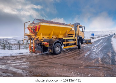 15.12.2019 Ribblehead, North Yorkshire, UK, A yellow gritter lorry out on the rd between Ribblehead and Hawes clearing snow and ice from from the road surface.