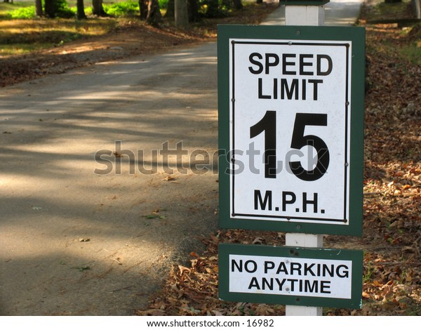 15mph speedlimit sign on a shady road