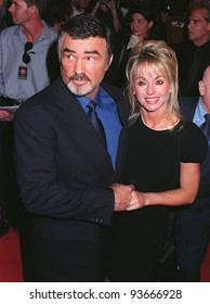 """15OCT97: Actor BURT REYNOLDS & girlfriend PAMELA SEALS at the premiere of his new movie """"Boogie Nights,"""" in Hollywood."""
