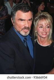 """15OCT97: Actor BURT REYNOLDS & girlfriend PAMELA SEALS at the premiere of his new movie, """"Boogie Nights."""" The movie is about a family of actors & filmmakers in the adult movie business."""
