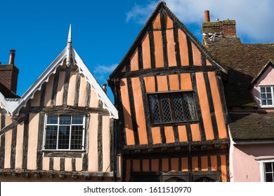 15th century Crooked House antiques shop and tearooms in quaint wonky crooked orange timbered building in High Street, Lavenham, Suffolk, England, UK.