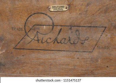 15th July 2018- The wooden name plate on a 1930's Richards wheelchair, originally supplied by Halfords, displayed at a vintage show at the Gwili Railway, Bronwydd Arms, Carmarthenshire, Wales, UK.