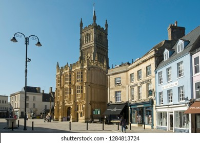 15th March 2017 - Cirencester, UK: Spring sunshine brings locals and visitors to the recently regenerated historic Market Place by the abbey church in Cirencester, Gloucestershire, UK.