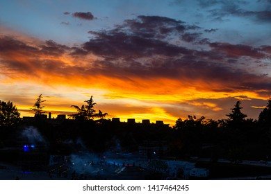 15th May 2019 – Madrid, Spain: sunset behind the stage in Parque Tierno Galvan before the fireworks show during the San Isidro Festival of Madrid