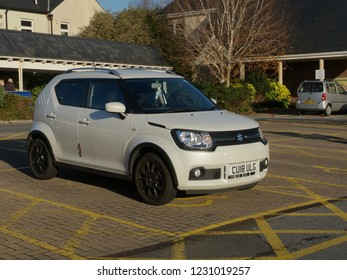15th November 2018- A cute Suzuki Ignis hatchback in the public carpark at a shopping area in Carmarthen, Carmarthenshire, Wales, UK.