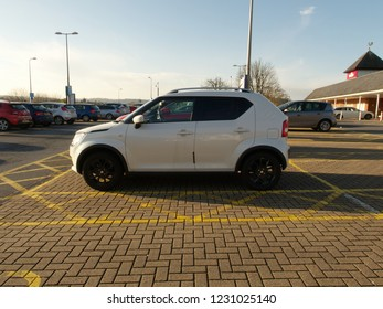 15th November 2018- A Suzuki Ignis hatchback in the public carpark at a shopping ares in Carmarthen, Carmarthenshire, Wales, UK.