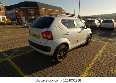 15th November 2018- A Suzuki Ignis hatchback in the public carpark at a shopping area in Carmarthen, Carmarthenshire, Wales, UK.