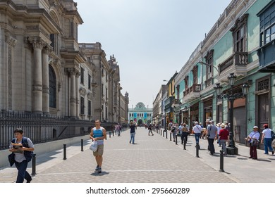 16 APR 2015 : European travellers walking around plaza de arms of Lima City, Peru