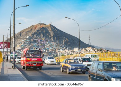 16 Apr 2015 : Lima dowtown with house on hill and movement of car to main land, Lima, Peru