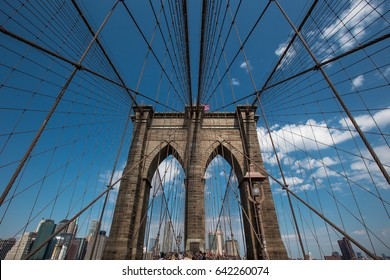 16 APRIL 2017 - New York City - Perspective view of Brooklyn Bridge on blue sky background