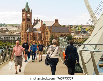 16 August 2016 Pedestrians crossing the iconic Peace Bridge over the river Foyle in londonderry city in Northern Ireland
