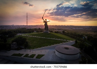 """16 August 2017. Sun is going down over the statue """"The Motherland calls"""" on the top of the Mamaev Hill in Volgograd, Russia - aerial view taken by drone."""