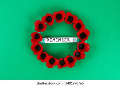 16 Diy wreath red poppy Anzac Day, Remembrance, Remember, Memorial day made of cardboard egg trays on green background. Gift idea, decor. Step by step. Top view. Process kid children craft. Workshop.